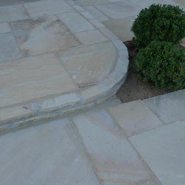 slidte rumlede brosten natursten sandsten Sandstone